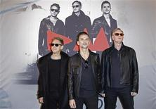 (From L-R) Martin Gore, Dave Gahan and Andrew Fletcher of British band Depeche Mode pose during a photocall before a press conference in Paris to announce the dates for their 2013/2014 world tour October 23, 2012. REUTERS/Benoit Tessier