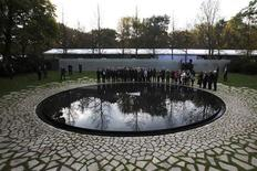"People attend the inauguration of the ""Memorial to the Sinti and Roma of Europe Murdered under National Socialism"" in Berlin October 24, 2012. REUTERS/Thomas Peter"