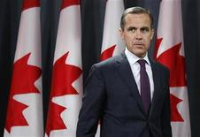 Bank of Canada Governor Mark Carney arrives at a news conference upon the release of the Monetary Policy Report in Ottawa October 24, 2012. REUTERS/Chris Wattie