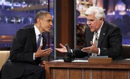 U.S. President Barack Obama speaks to host Jay Leno (R) as he makes an appearance on the Tonight Show in Los Angeles, California October 24, 2012. Obama is on a two-day, eight-state campaign swing. REUTERS/Kevin Lamarque