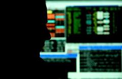 A city trader monitors stock prices in London.