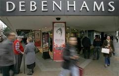 Pedestrians walk past the Debenhams store on Oxford Street, in central London October 19, 2008. REUTERS/Andrew Winning