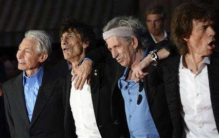 The Rolling Stones members Charlie Watts, Ronnie Wood, Keith Richards and Mick Jagger arrive for the world premiere of the Rolling Stones documentary ''Crossfire Hurricane'' at the Odeon Leicester Square in London October 18, 2012. REUTERS/Paul Hackett