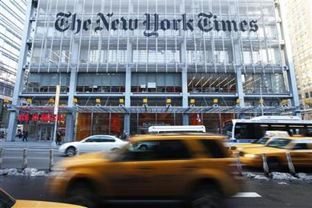 Vehicles drive past the New York Times headquarters in New York March 1, 2010. REUTERS/Lucas Jackson