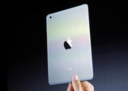 The new iPad mini is projected on a screen at an Apple event in San Jose, California October 23, 2012. REUTERS/Robert Galbraith