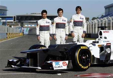 Sauber Formula One drivers Kamui Kobayashi (L) of Japan, Sergio Perez (C) of Mexico and compatriot Esteban Gutierrez pose next to the C31-Ferrari during the official presentation of the Sauber Formula One Team 2012 at the Jerez racetrack in southern Spain February 6, 2012. REUTERS/Marcelo del Pozo