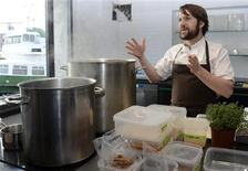 Rene Redzepi, chef and co-owner of the restaurant Noma, talks with his employees in a test kitchen in his restaurant in Copenhagen October 25, 2012. REUTERS/Fabian Bimmer