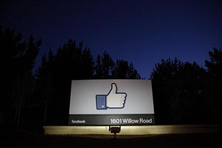 The sun rises behind the entrance sign to Facebook headquarters in Menlo Park before the company's IPO launch in this file May 18, 2012 photo. REUTERS/Beck Diefenbach