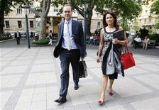 The IMF's Mission Chief for Hungary, Thanos Arvanitis (L) and the Fund's Representative in Hungary Iryna Ivaschenko walk in the streets of Budapest after leaving a meeting at the National Bank of Hungary, July 17, 2012. REUTERS/Bernadett Szabo
