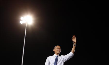 U.S. President Barack Obama waves to supporters after speaking at a campaign rally in Las Vegas, Nevada October 24, 2012. REUTERS/Kevin Lamarque