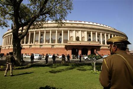 A policeman keeps vigil at the parliament house in New Delhi February 26, 2005. REUTERS/B Mathur/Files