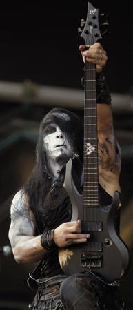 Nergal, also known as Adam Michal Darski, the guitarist of Behemoth performs during the Hellfest music Festival in Clisson, western France in this June 20, 2010 file photo. REUTERS/Stephane Mahe/Files