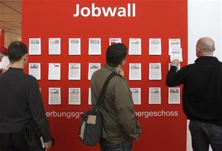 Visitors look at a wall with job offers at the ''Hannover Messe'' industrial trade fair in Hanover April 22, 2008. REUTERS/Christian Charisius