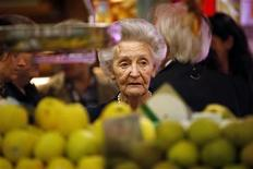 A customer shops for fruit and vegetables at Madrid's Chamberi market April 12, 2011. REUTERS/Susana Vera