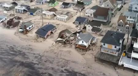 Aviators of the 1-150th Assault Helicopter Battalion of the New Jersey National Guard, look for displaced residents along the New Jersey coastline in the aftermath of Hurricane Sandy, as seen in this image captured from video taken by the New Jersey National Guard, October 30, 2012. REUTERS/U.S. Air Force/Master Sgt. Mark C. Olsen/Handout