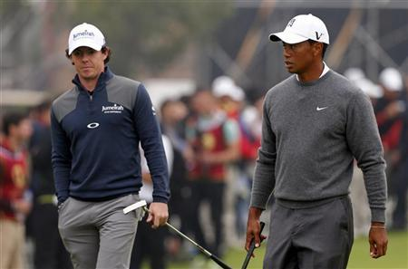 Tiger Woods (R) of the U.S. and Rory McIlroy of Northern Ireland warm up before their matchplay exhibition event at the Jinsha Lake Golf Club in the Chinese city of Zhengzhou, Henan Province October 29, 2012. REUTERS/David Gray