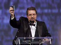"""Will Ferguson toasts to the audience during his speech after winning the Scotiabank Giller Prize for his novel """"419"""" at the Ritz-Carlton in Toronto October 30, 2012. REUTERS/Matthew Sherwood"""