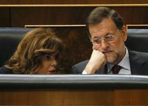 Spain's Prime Minister Mariano Rajoy (R) listens to Deputy Prime Minister Soraya Saenz de Santamaria at the Spanish parliament before his speech on the results of the last European Council in Madrid October 31, 2012. REUTERS/Andrea Comas