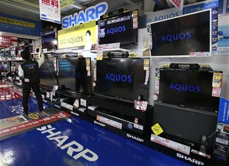 Sharp Corp's Aquos TVs are displayed at an electronics store in Tokyo October 28, 2012. REUTERS/Yuriko Nakao/Files