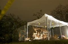 A tent protects the skeletal remains of at least two individuals which were unearthed when a 100-year-old oak tree fell on the Green in New Haven, Connecticut after Hurricane Sandy hit the area October 31, 2012. REUTERS/Michelle McLoughlin