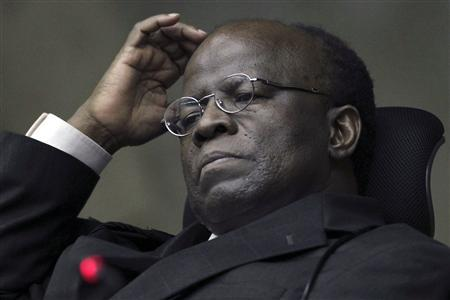 Justice Joaquim Barbosa reacts during the 'mensalao' or 'big monthly payments' trial at the Supreme Court in Brasilia in this October 23, 2012 file photo. As the biggest corruption trial in Brazilian history comes to an end with convictions of once-powerful politicians, at least one hero has emerged from the mess, Barbosa, the bricklayer's son who is the first black member of the Supreme Court. Picture taken October 23, 2012. REUTERS-Ueslei Marcelino-Files