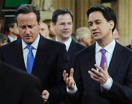 Britain's Prime Minister David Cameron (L) listens to opposition Labour leader Ed Miliband as they process to the House of Lords to listen to the Queen's Speech during the State Opening of Parliament in central London May 9, 2012. REUTERS/Stefan Rousseau/Pool