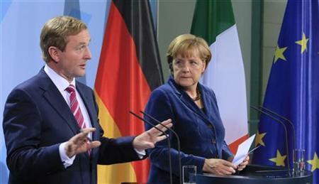 German Chancellor Angela Merkel (R) and Ireland's Prime Minister Enda Kenny address the media after talks in Berlin November 1, 2012. REUTERS/Tobias Schwarz