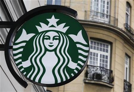 The Starbucks logo is seen outside the new Starbucks cafe in Warsaw March 6, 2011. REUTERS/Kacper Pempel