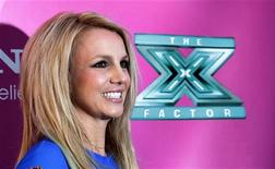 """Judge Britney Spears poses at the season two premiere of the television series """"The X Factor"""" at Grauman's Chinese theatre in Hollywood, California September 11, 2012. REUTERS/Mario Anzuoni"""