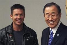 Pilot Felix Baumgartner of Austria (L) and U.N. Secretary-General Ban Ki-moon smile as they talk to each other during a photo opportunity at the UN headquarters in New York, October 23, 2012. REUTERS/Eduardo Munoz