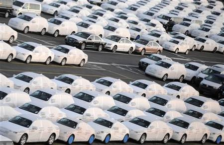 Audi cars are pictured at a shipping terminal in the harbour of the German northern town of Bremerhaven, March 8, 2012. Volkswagen AG's luxury unit Audi said April 10, 2012, sales rose 14.1 percent in March to a record 143,500 vehicles, maintaining the car maker's lead over Daimler Ag's Mercedes-Benz brand. Audi overtook Mercedes-Benz as the second-largest premium brand by vehicle sales last year and has surpassed BMW in terms of profitability thanks to the economies of scale it enjoys with its parent VW. Picture taken March 8. REUTERS/Fabian Bimmer (GERMANY - Tags: TRANSPORT BUSINESS INDUSTRIAL)