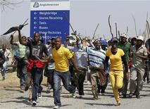 Mineworkers take part in a march outside the Anglo American mine in South Africa's North West Province, September 12, 2012. REUTERS/Siphiwe Sibeko