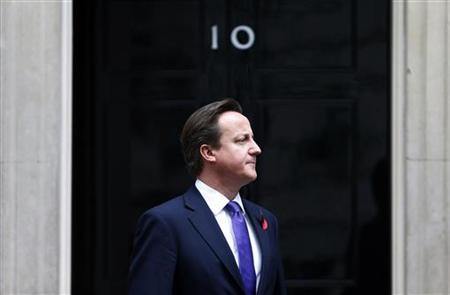Britain's Prime Minister David Cameron stands outside Number 10 Downing Street in London November 1, 2012. Britain faces a crisis that could end with the world's sixth largest economy leaving the European Union, Deputy Prime Minister Nick Clegg warned ahead of a showdown over budget spending with other states in the 27-member bloc. A day after Prime Minister David Cameron was defeated in parliament for not demanding a cut to the EU budget, Clegg said on Thursday that the behaviour of the rebel lawmakers could leave Britain isolated in the EU or outside it altogether. REUTERS/Suzanne Plunkett (BRITAIN - Tags: POLITICS BUSINESS TPX IMAGES OF THE DAY)