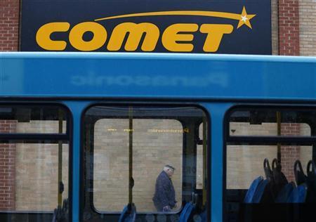 A shopper walks past a Comet store in Burton upon Trent, central England November 1, 2012. REUTERS/Darren Staples