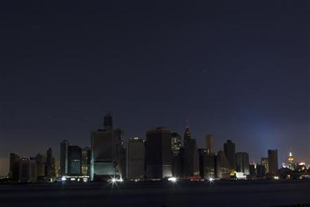 A largely powerless downtown Manhattan stands under a night sky due to a power blackout caused by Hurricane Sandy in New York October 31, 2012. REUTERS/Lucas Jackson