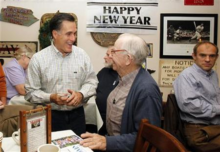 Republican presidential candidate and former Massachusetts Governor Mitt Romney (L) shares a laugh with a voter during his campaign stop at Old Salt Restaurant in Hampton, New Hampshire December 31, 2011. REUTERS/Jessica Rinaldi/Files