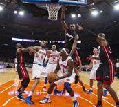 Miami Heat center Chris Bosh (1) leaps to block New York Knicks guard Ronnie Brewer (11) as he looks to shoot in the first quarter of their NBA basketball game at Madison Square Garden in New York, November 2, 2012. REUTERS/Ray Stubblebine