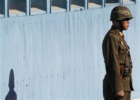 A North Korean soldier stands guard before the United Nations Command (UNC) hands over a coffin containing the body of a North Korean soldier to the North, at the truce village of Panmunjom in Paju, north of Seoul, October 18, 2012. The UNC repatriated the body of a North Korean soldier on Thursday. The soldier was found dead after floating down the Imjin River to South Korea last August when the North's region was flooded. REUTERS/Lee Jae-Won (SOUTH KOREA - Tags: MILITARY POLITICS)