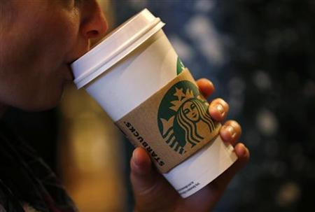 A customer sips her coffee in Starbucks' Mayfair Vigo Street branch in central London September 12, 2012. Picture taken September 12, 2012. To match Special Report BRITAIN-STARBUCKS/TAX REUTERS/Andrew Winning (BRITAIN - Tags: BUSINESS)
