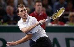 Jerzy Janowicz of Poland returns the ball during his semi-final men's singles match against Gilles Simon of France at the Paris Masters tennis tournament November 3, 2012. REUTERS/Benoit Tessier