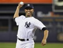 Injured New York Yankees closer Mariano Rivera throws out the ceremonial first pitch before Game 3 of their MLB ALDS baseball playoff series against the Baltimore Orioles in New York, October 10, 2012. REUTERS/Ray Stubblebine