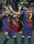 Barcelona's Jordi Alba celebrates with team mate David Villa after scoring a goal against Celta Vigo during their Spanish First division soccer league match at Camp Nou stadium in Barcelona November 3, 2012. REUTERS/Albert Gea