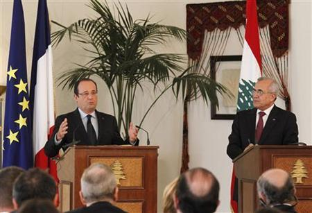 France's President Francois Hollande (L) speaks during a joint news conference with his Lebanese counterpart Michel Suleiman at the presidential palace in Baabda, near Beirut November 4, 2012. REUTERS/Mohamed Azakir