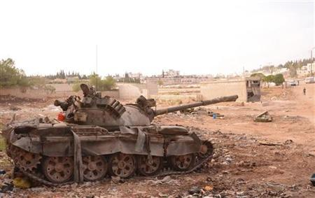 A Syrian army tank is seen in the Khan al-Assal area after clashes between Free Syrian Army fighters and forces loyal to Syria's President Bashar al-Assad, near Aleppo city, November 2, 2012. REUTERS/George Ourfalian
