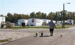 Jason Calvin walks his dogs in Joplin, Missouri October 20, 2012 at the FEMA mobile home park where he lives. An affordable place to live in the wake of disasters such as Hurricane Sandy can become a prolonged need, as some survivors of the massive 2011 tornado in Joplin, Missouri can attest. More than 17 months after the tornado that killed 161 people and destroyed more than 8,000 buildings, FEMA still provides 142 furnished mobile homes free of charge to residents who have no permanent place to live. REUTERS/Kevin Murphy