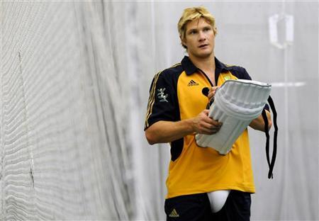 Australia's Shane Watson carries equipment during an indoor cricket training session before the first Ashes Test against England at Cardiff, Wales July 6, 2009. REUTERS/Philip Brown