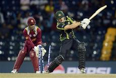 Australia's Shane Watson is bowled as West Indies' Denesh Ramdin (L) looks on during the ICC world Twenty20 semi-final at the R Premadasa Stadium, Colombo October 5, 2012. REUTERS/Philip Brown