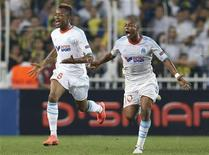 Olympique Marseille's Andre Ayew (R) celebrates with his teammate Jordan Ayew after scoring their second goal against Fenerbahce during their Europa League Group C soccer match at Sukru Saracoglu stadium in Istanbul September 20, 2012. REUTERS/Murad Sezer