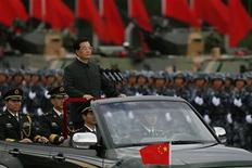 Chinese President Hu Jintao attends a military parade during his visit to an airbase in Hong Kong in this June 29, 2012 file photo, two days before the 15th anniversary of the territory's handover to Chinese sovereignty from British rule. REUTERS/Bobby Yip/Files