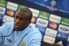 Manchester City's Yaya Toure attends a news conference ahead of their practice session at the club's Carrington training complex in Manchester October 2, 2012. REUTERS/Nigel Roddis